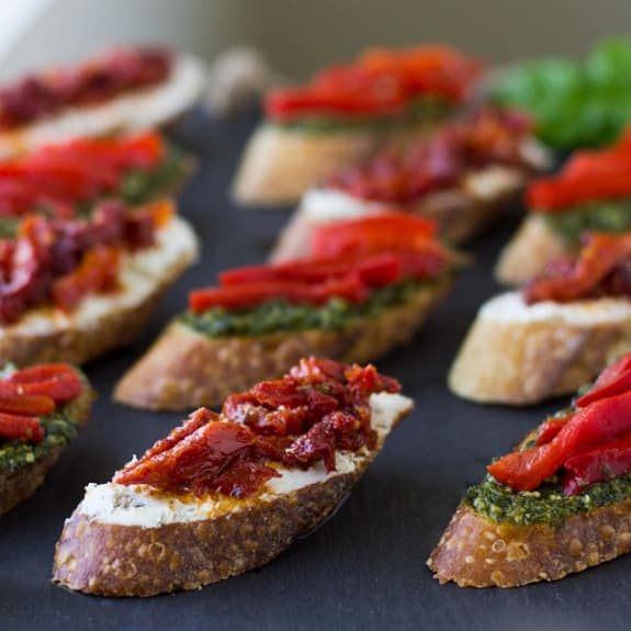 oven baked tomatoes and brie crostini