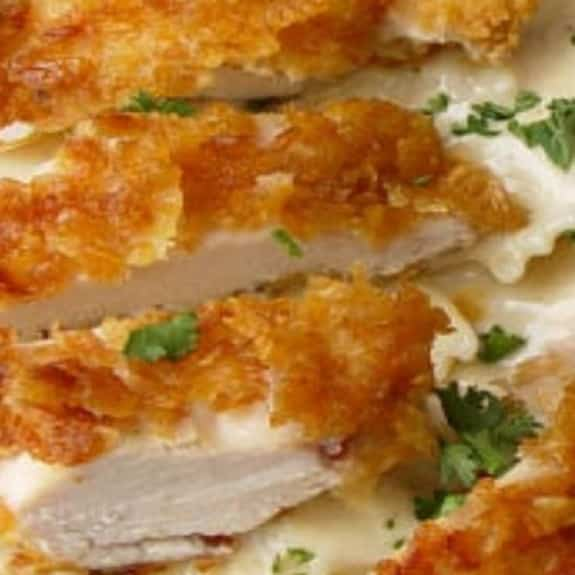 crispy chicken with creamy italian sauce and noodles