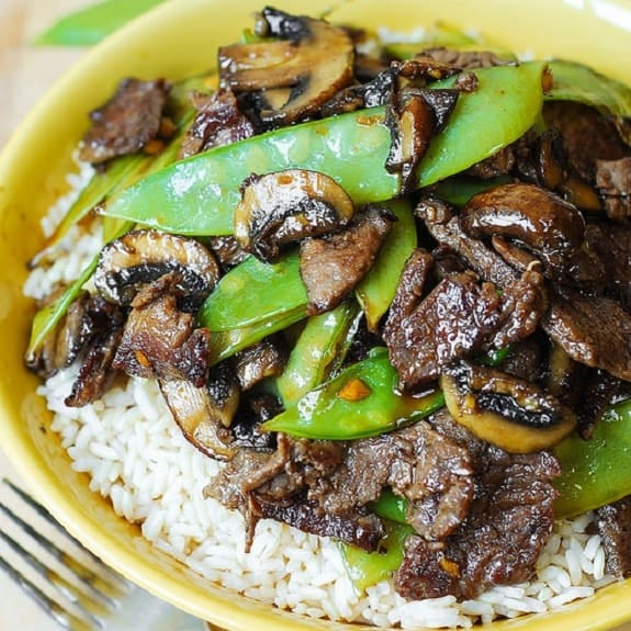 fried beef with mushrooms and snow peas