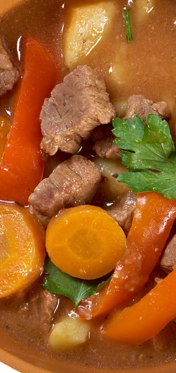 Slow cooker vegetable beef stew recipe. Cubed stewing beef with vegetables and dry red wine cooked in a slow cooker. Very easy and delicious!#slowcooker #crockpot #dinner #stew #beef #homemade