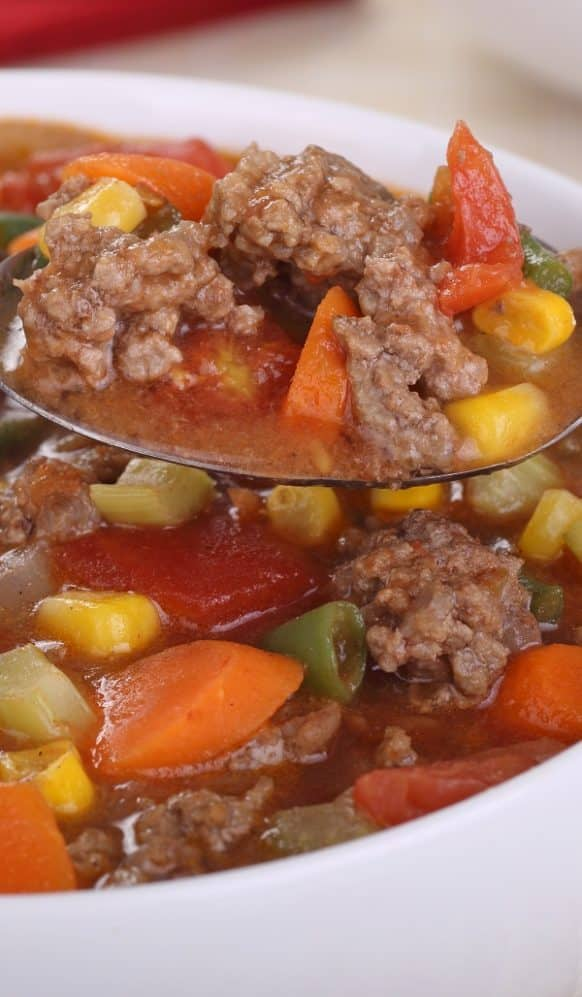 Slow cooker beef vegetable soup. Ground beef with vegetables, green beans, and Worcestershire sauce cooked in a slow cooker. #slowcooker #crockpot #soup #beef #dinner #homemade #vegetables #yummy
