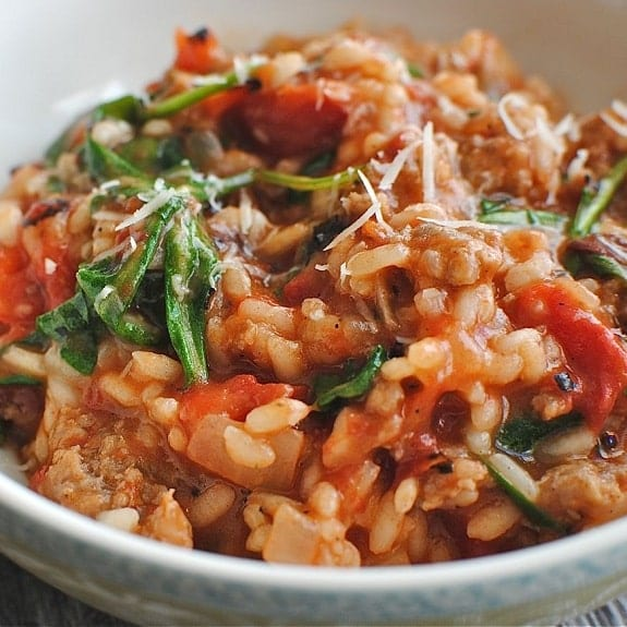 oven baked risotto with sausages and tomatoes