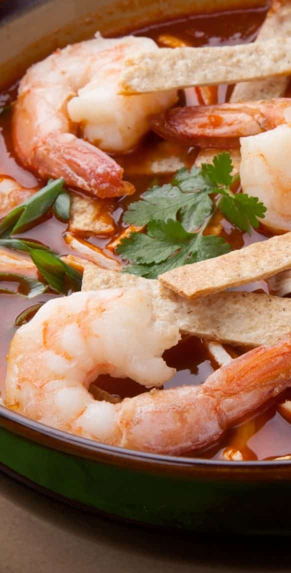 Slow cooker Mexican shrimp soup recipe. Delicious Mexican soup with shrimp and vegetables cooked in slow cooker. #slowcooker #crockpot #seafood #shrimp #soup #mexican