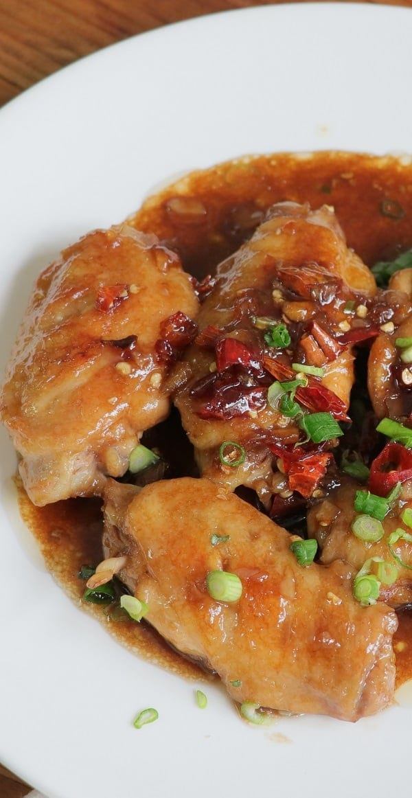 Pressure cooker Coca-Cola chicken wings. This recipe belongs to Chinese cuisine. Chicken wings with Coca-Cola, wine, and soy sauce cooked in a pressure cooker. #pressurecooker #instantpot #chicken #dinner #appetizers #party #homemade #yummy #wings