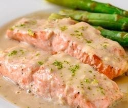 Pressure cooker salmon steaks with creamy mustard sauce. Fresh salmon steaks with dry white, mustard, and vegetables cooked in a pressure cooker. #pressurecooker #instantpot #seafood #salmon #steaks #creamy #dinner #homemade