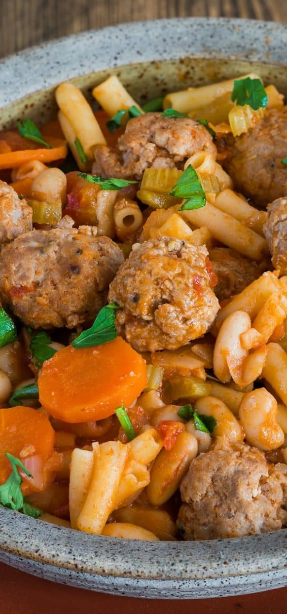 Slow cooker meatball pasta stew. Romano meatballs with vegetables and pasta cooked in slow cooker.#slowcooker #crockpot #meatballs #pasta #stew #dinner #homemade