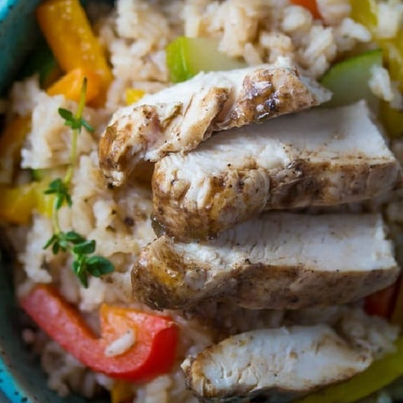 pan roasted chicken breasts with rice and vegetables