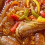 Pressure cooker Italian sausages with onions and peppers. Italian sausages with vegetables and dry white wine cooked in a pressure cooker. Very easy and delicious. #pressurecooker #instantpot #dinner #italian #sausages #homemade