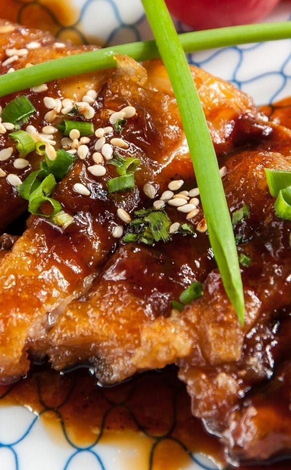 Pressure cooker teriyaki chicken thighs recipe. Chicken thighs with soy sauce, sake, and spices cooked in a stovetop pressure cooker and served over cooked rice. #pressurecooker #instantpot #chicken #teriyaki #homemade #dinner