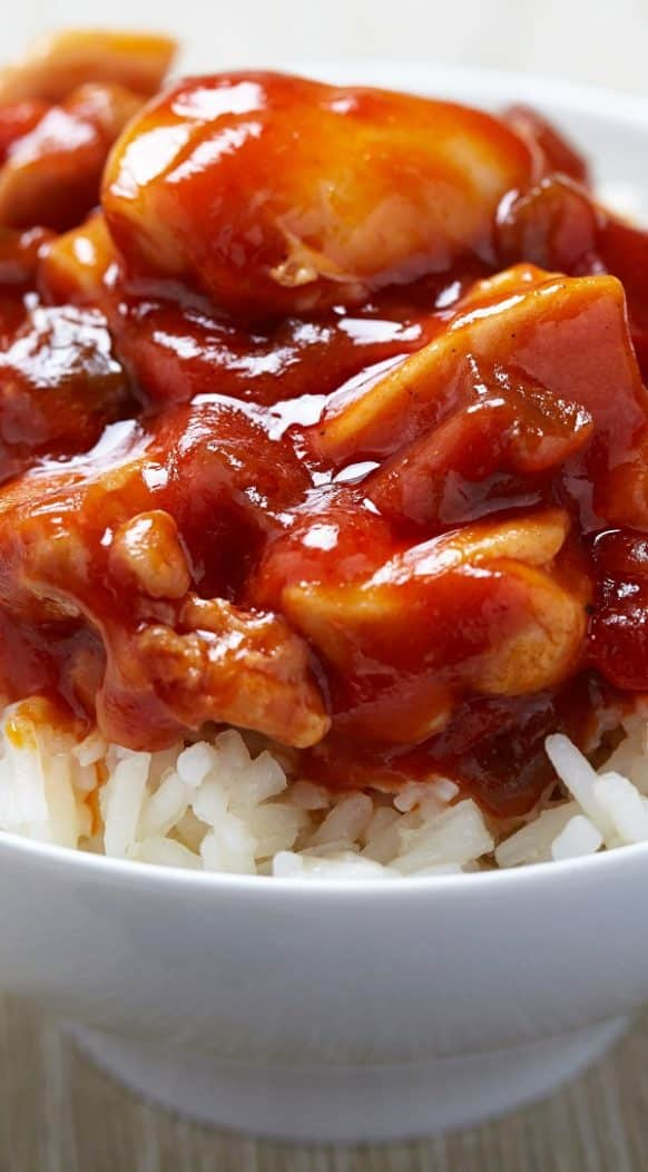 Pressure cooker Chinese simmered spicy chicken recipe. Chicken pieces with soy sauce, ketchup, dry red wine, and spices cooked in a pressure cooker. #pressurecooker #instantpot #chicken #spicy #chinese #dinner #homemade