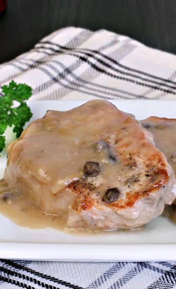 Pressure cooker creamy mushroom pork chops recipe. Boneless pork chops with mushrooms, cream of mushroom soup, vegetables, and Worcestershire sauce cooked in a pressure cooker. #pressurecooker #instantpot #pork #chops #dinner #creamy Mushroom #homemade #recipe