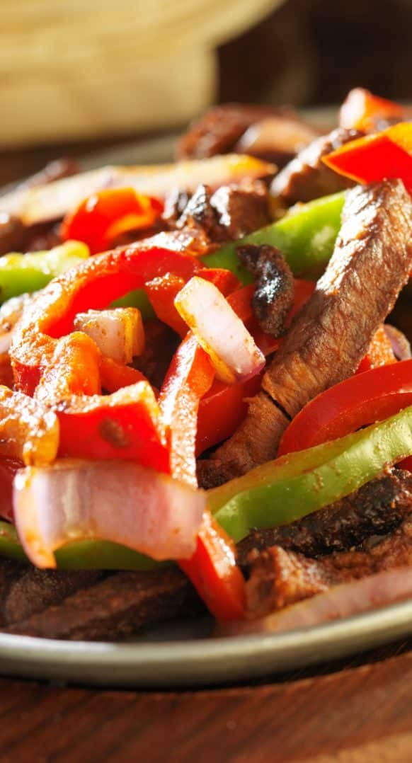 Pressure cooker beef fajitas recipe. Beef round steak with spices and sweet bell pepper cooked in a pressure cooker and served in warm tortillas. Juicy, tender, and flavorful. #recipes #pressurecooker #instantpot #mexican #homemade #beef #dinner #delicious