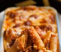 Slow cooker macaroni-tomato casserole recipe. Italian penne pasta (use elbow macaroni as a substitute) with vegetables, spices, and cheese cooked in a slow cooker. #slowcooker #crockpot #homemade #dinner #casserole #macaroni #pasta #onepot