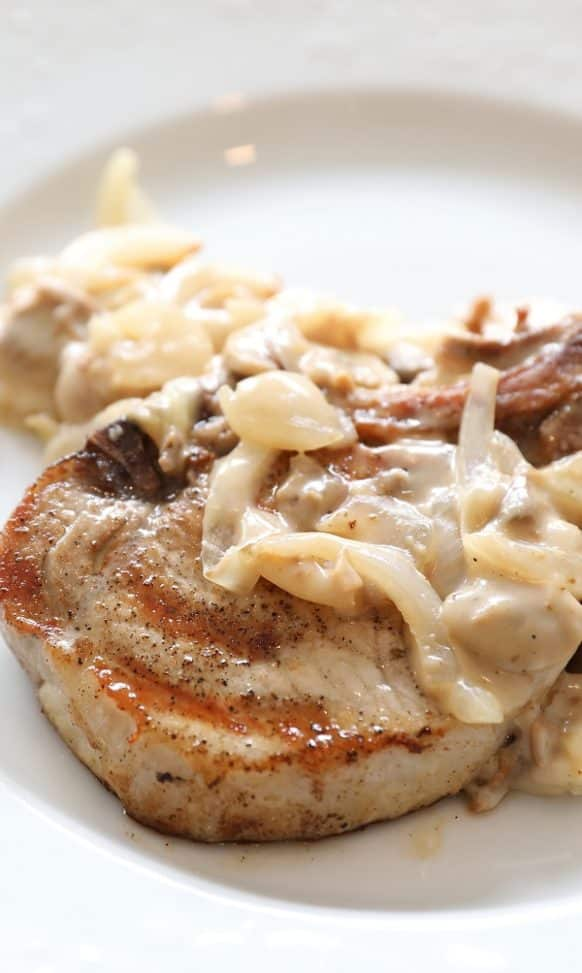 Pressure cooker pork chops with mushroom gravy recipe. Bone-in pork chops with delicious homemade mushroom gravy cooked in a pressure cooker. #pressurecooker #instantpot #dinner #pork #chops #mushrooms #homemade