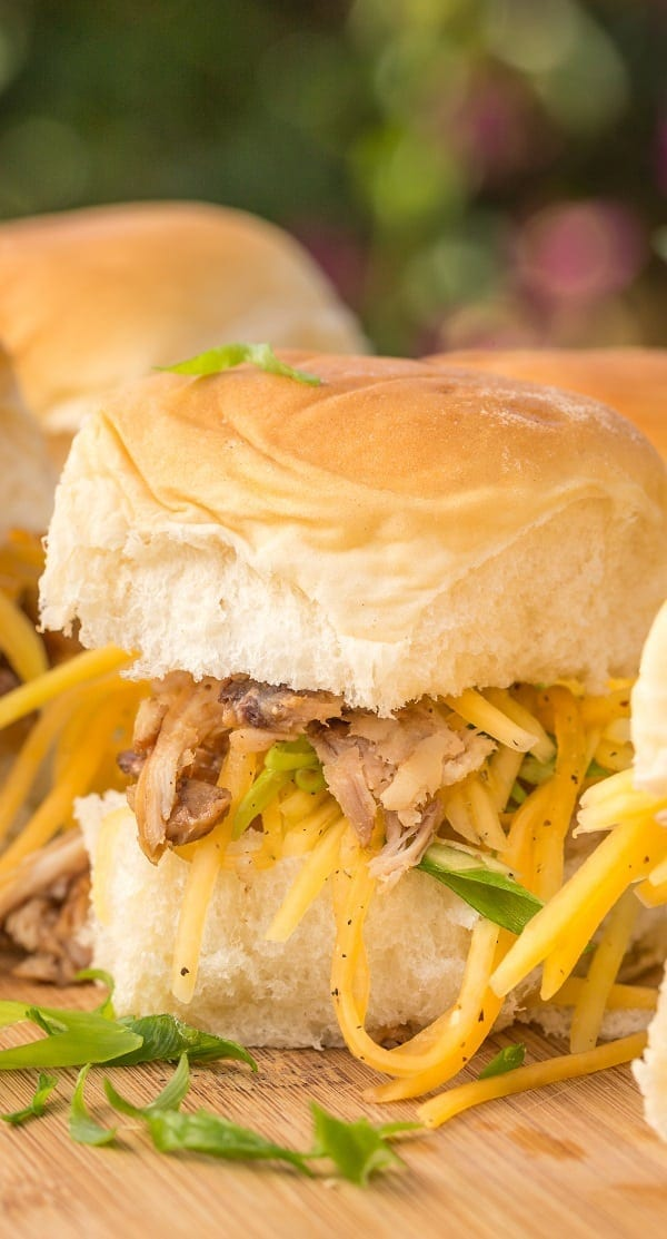 Slow cooker Kalua pork sliders recipe. Pork shoulder roast cooked in a slow cooker and served with vegetables and spices on sweet Hawaiian rolls. #slowcooker #crockpot #pork #sliders #dinner #homemade
