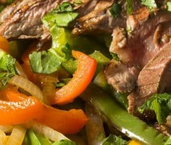 Slow cooker traditional beef fajitas recipe. This delicious recipe belongs to Mexican cuisine - beef flank steak with vegetables and spices cooked in a slow cooker. #slowcooker #crockpot #beef-#fajitas #mexican #dinner #homemade