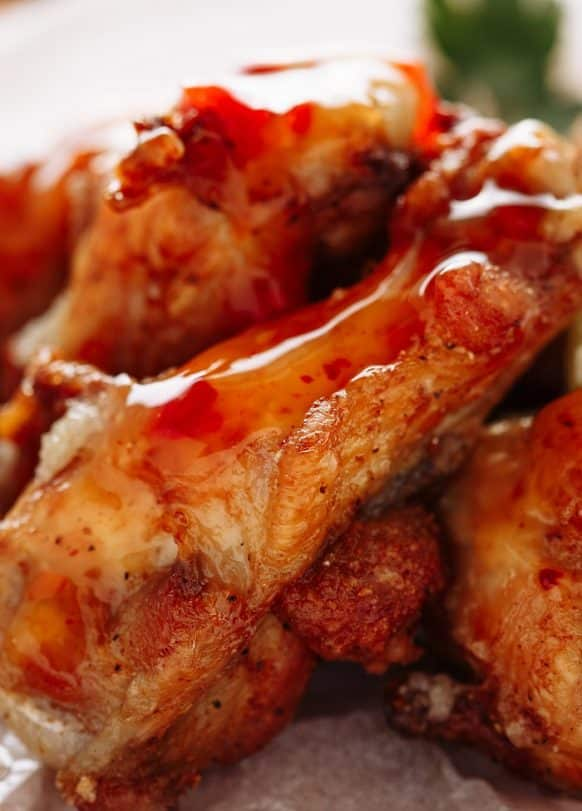 Slow cooker apricot BBQ chicken wings recipe. Chicken wings with apricot preserves, BBQ sauce, and spices cooked in a slow cooker. #slowcooker #crpckpot #bbq #chicken #wings #appetizers #party #easy #dinner #yummy