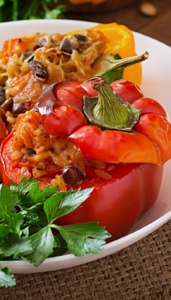 Slow cooker bean and rice stuffed peppers. Bell peppers stuffed with beans, rice, and cheese cooked in a slow cooker. #slowcooker #crockpot #vegetarian #vegan #dinner #homemade #rice #beans