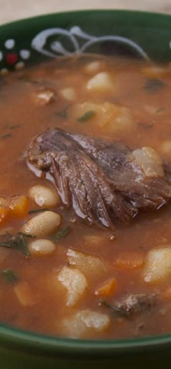 Slow cooker beef and bean soup recipe. Meaty beef chunks with beans and vegetables cooked in a slow cooker. #slowcooker #crockpot #beef #neans #dinner #homemade #soup