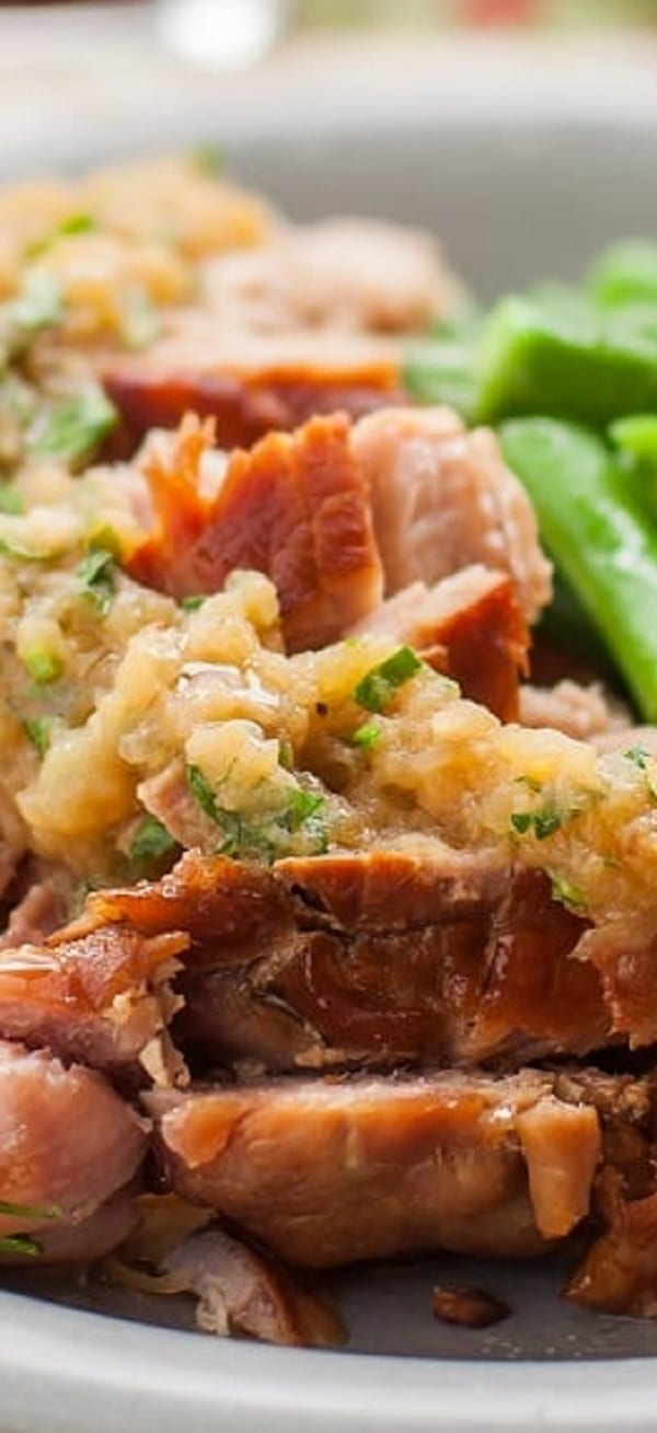 Slow cooker applesauce pork roast recipe. Pork roast with applesauce and spices cooked in a slow cooker. Serve it with cooked green beans. #slowcooker #crockpot #pork #roast #dinner #homemade