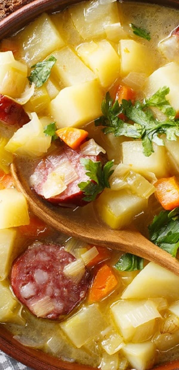 """Slow cooker German potato soup recipe. German potato soup with smoked sausages and cabbage also is known as """" Kartoffelsuppe"""" cooked in a slow cooker. #slowcooker #crockpot #soup #dinner #potato #german #dinner #lunch #easy"""