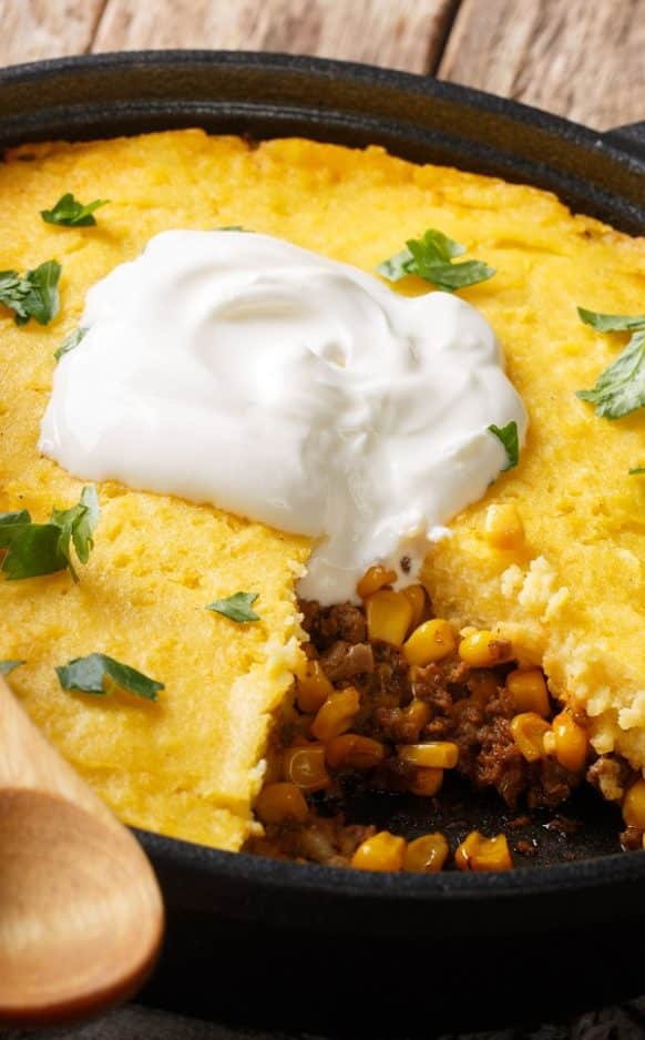 Slow cooker tamale pie recipe. A very simple and tasty Mexican pie cooked in a slow cooker. #slowcooker #crockpot #dinner #pie #mexican #homemade