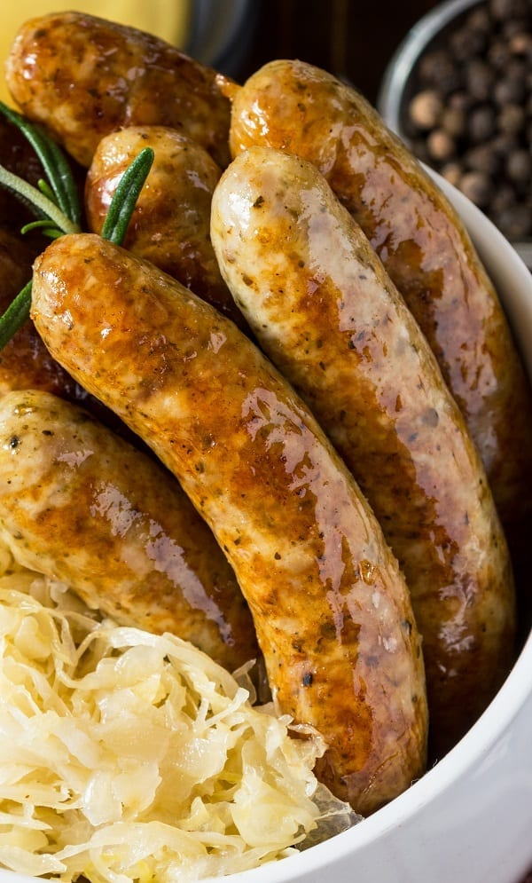 Crock pot brats in beer. Sausages with vegetables and spiced cooked in a crock pot. Easy and tasty. #crockpot #slowcooker #easy #dinner #sausages #brats #beer