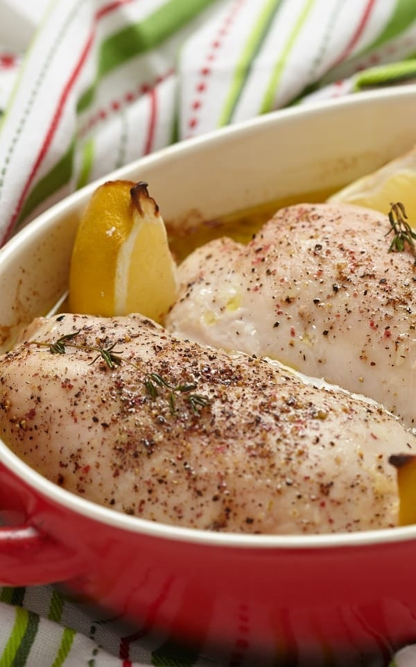 Crockpot lemon garlic turkey breasts recipe. Boneless and skinless turkey breasts with vegetables cooked in a crock pot. Simple and tasty! #slowcooker #crockpot #turkey #dinner #easy