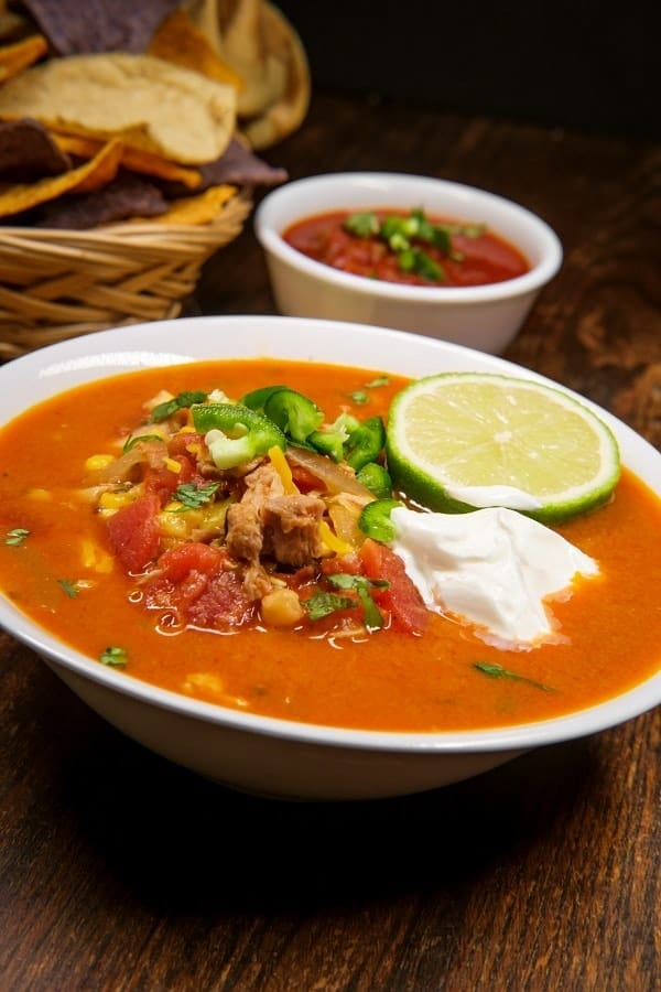 Slow cooker chicken taco soup recipe. Very easy and delicious Mexican soup. I love Mexican cuisine, it is so flavorful! Chicken breasts with beans, corn, salsa, and tomato sauce cooked in a slow cooker. #slowcooker #rockpot #dinner #mexican #chicken #taco #soup