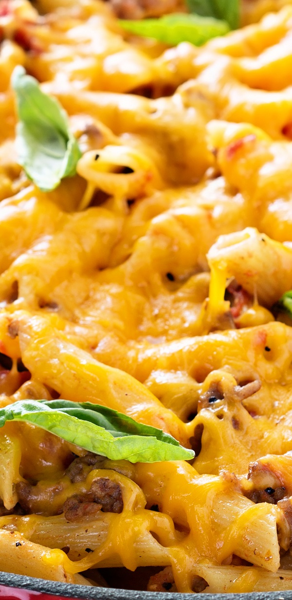 Penne pasta with vegetables and spices cooked in a slow cooker and served with grated Cheddar cheese. Very easy and tasty. #slowcooker #crockpot #pasta #dinner #casserole #lunch