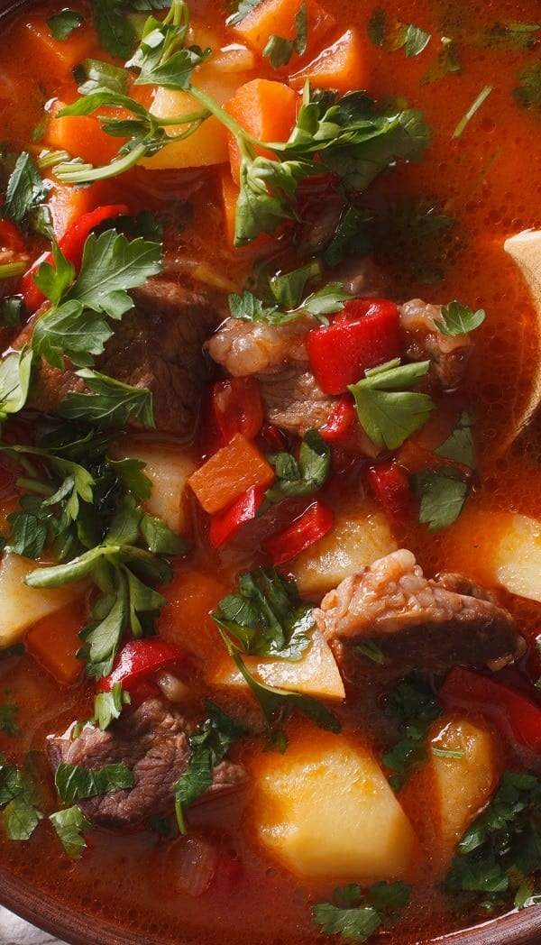 Slow cooker peppered pork and wine stew. Pork tenderloin with vegetables and dry white wine cooked in a slow cooker. Cubed boneless pork loin can be substituted for the tenderloin for a more economical stew. #slowcooker #crockpot #dinner #pork #stew