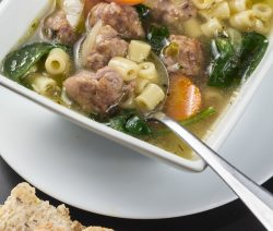 Easy crock pot Italian wedding soup recipe. Very Popular Italian meatball soup cooked in a crock pot. Super delicious! Italian wedding soup derived its name from the marriage of beef and herbs. #slowcooker #crockpot #dinner #italian #soup #wedding #recipes #healthy