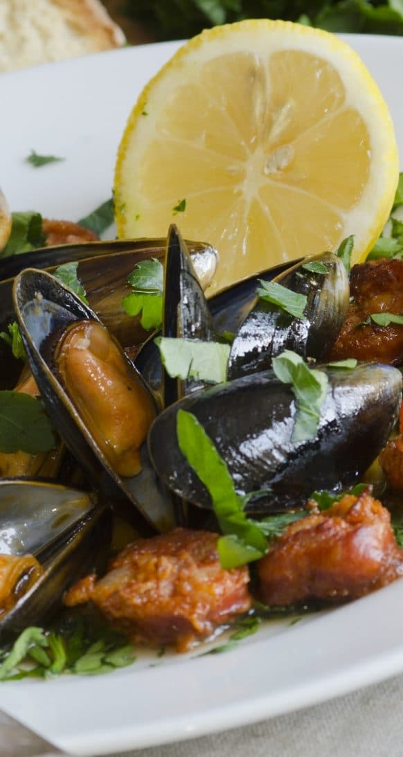 Pressure cooker mussels with sausage and beer recipe. Mussels with Italian hot sausages, beer, and vegetables cooked in a pressure cooker. Extremely delicious! #pressurecooker #instantpot #seafood #dinner #mussels #sausages