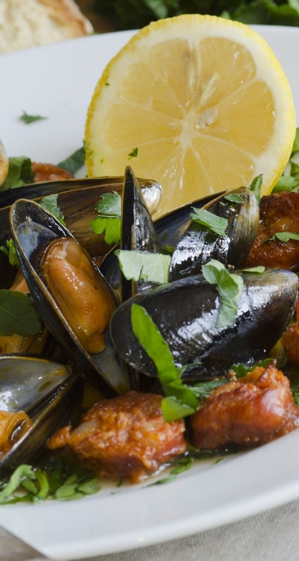 Pressure cooker mussels with sausage and beer recipe. Mussels with Italian hot sausages,beer, and vegetables cooked in a pressure cooker. Extremely delicious! #pressurecooker #instantpot #seafood #dinner #mussels #sausages