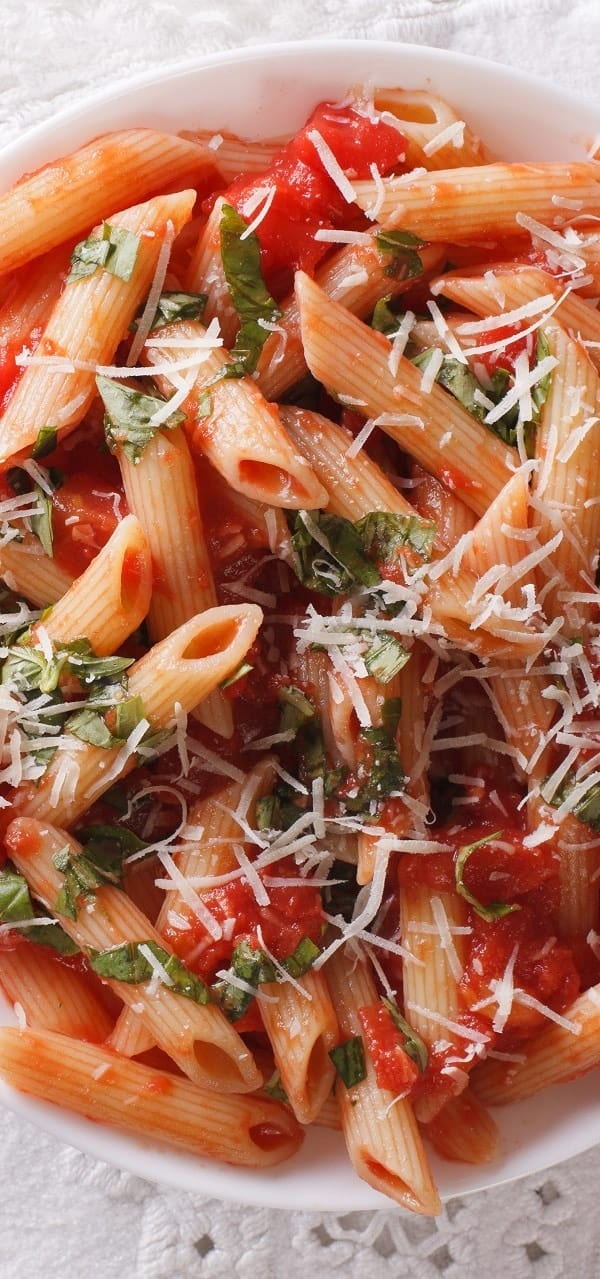 Slow cooker Arrabbiata sauce pasta recipe. An excellent traditional Italian sauce cooked in a slow cooker and served over cooked penne pasta. #pasta #slowcooker #crockpot #dinner #homemade #yummy #lunch