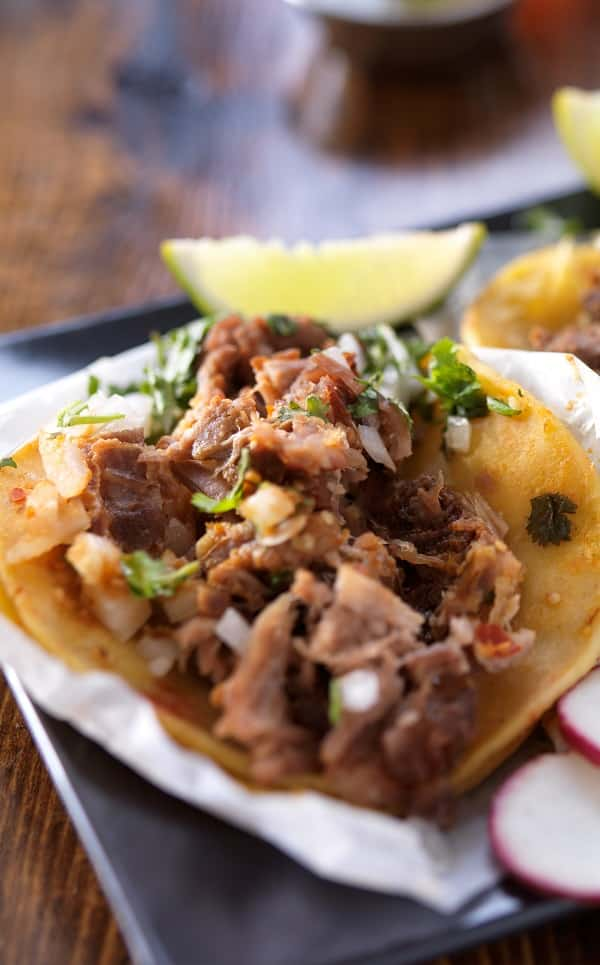 Slow cooker beef carnitas tacos. This is a delicious Mexican recipe. Beef with vegetables cooked in a slow cooker and served with salsa and tortillas. #slowcooker #crockpot #beef #carnitas #tacos #dinner #mexican
