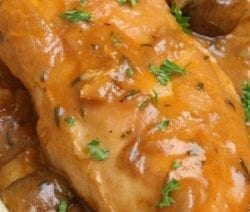 Slow cooker chicken in mushroom gravy. This is very easy and delicious chicken recipe. Chicken breasts with creamy mushroom soup, dry white wine, and mushrooms cooked in a slow cooker. #slowcooker #rockpot #chicken #dinner #mushroom #gravy