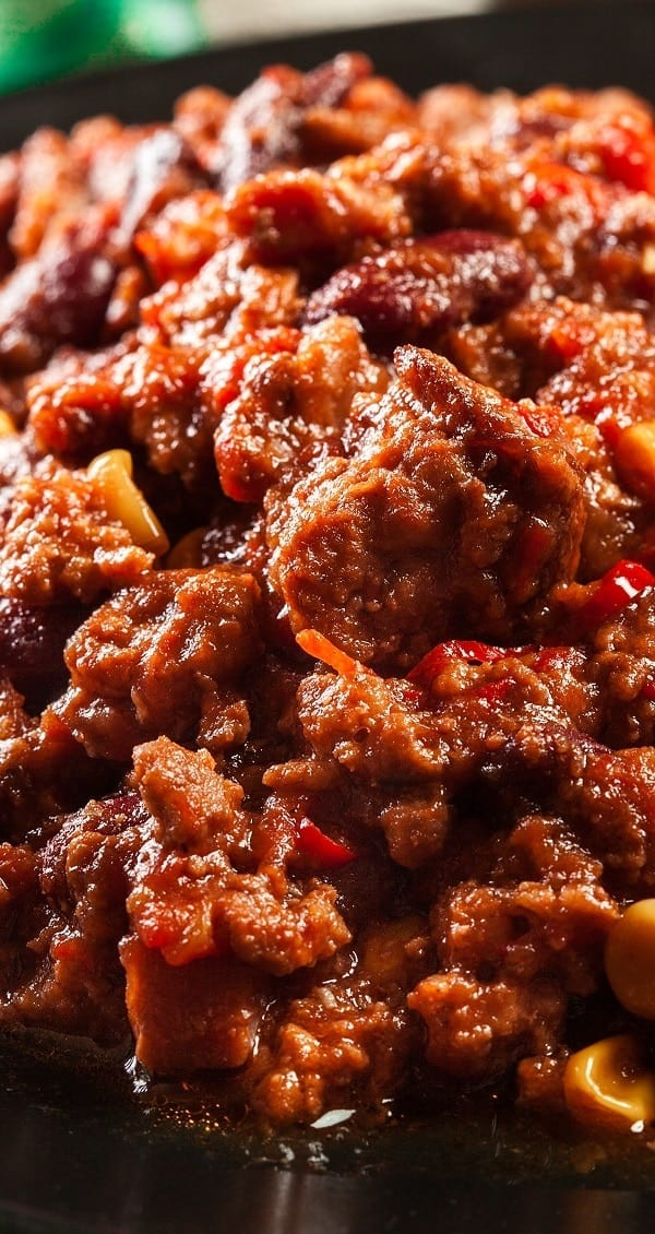 Slow cooker easy beef bean chili recipe. Ground beef with vegetables, beans, and spices cooked in a slow cooker. #slowcooker #crockpot #dinner #chili #beef #beans #homemade