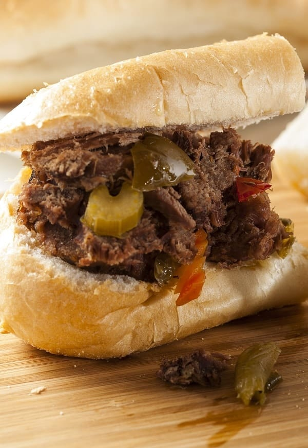 Slow cooker spicy Italian beef. Boneless beef chuck roast with beer, spicy pickles, and vegetables cooked in slow cooker. #slowcooker #crockpot #dinner #sandwiches #beef #spicy