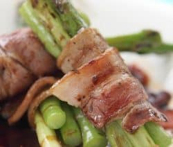 Bacon-wrapped asparagus appetizer recipe. Asparagus wrapped in bacon and baked in an oven. Very easy and tasty appetizer. #appetizers #party #dinner #homemade #asparagus #bacon #yummy