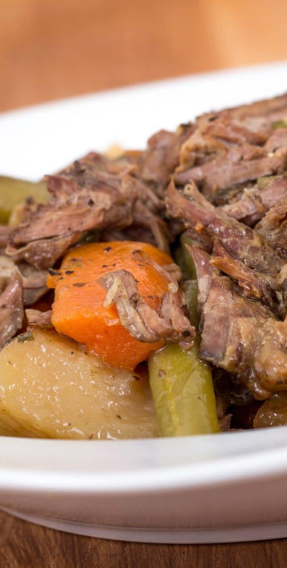 Slow cooker beef pot roast recipe. Beef chuck roast with vegetables and spices cooked in a slow cooker. #slowcooker #crockpot #dinner #beef #vegetables