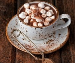Slow cooker hot chocolate. Very delicious dessert cooked in a slow cooker. Add marshmallows to each cup of hot chocolate. #slowcooker #crockpot #dessert #chocolate #homemade