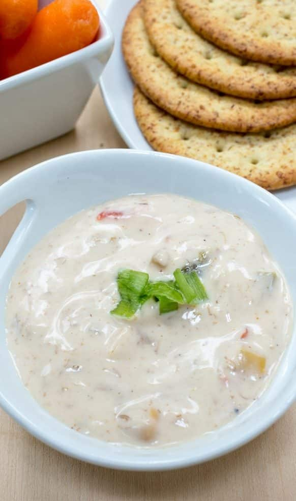 Slow cooker hot crab dip recipe. Yummy creamy seafood appetizer cooked in a slow cooker. #slowcooker #crockpot #dip #appetizers #seafood #crab #homemade