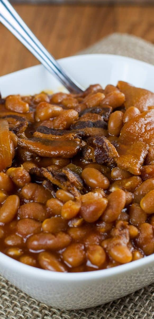 Slow cooker saucy baked beans recipe. Dried beans with vegetables, bacon, and Worcestershire sauce cooked in a slow cooker.#slowcooker #crockpot #beans #dinner #homemade #easy #yummy