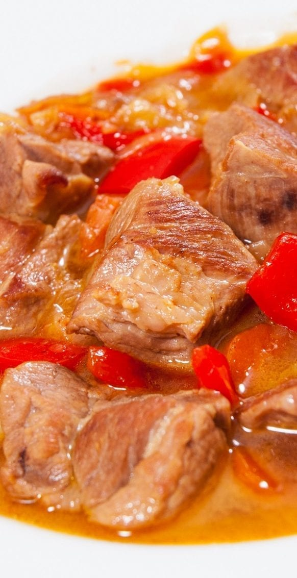 Pressure cooker pork stew with sherry and red wine. Cubed pork shoulder meat with dry red wine, sherry, vegetables, and greens cooked in a pressure cooker. #pressurecooker #instantpot #pork #stew #dinner #homemade
