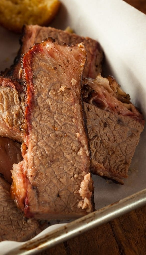 Slow cooker barbecued beef brisket. This yummy beef brisket is prepared with an easy spice rub and cooked with popular barbecue sauce in a slow cooker. #slowcooker #crockpot #beef #dinner #barbecue