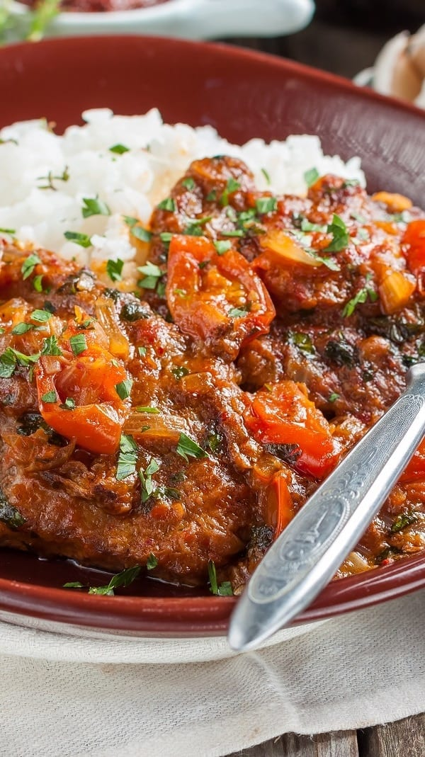 Slow cooker beef in spicy tomato sauce. Beef stewing meat with vegetables and spices cooked in a slow cooker. This delicious and simple beef stew is very easy to make in your electric instant pot, slow cooker, or stove. #slowcooker #crockpot #dinner #beef #spicy #tomato