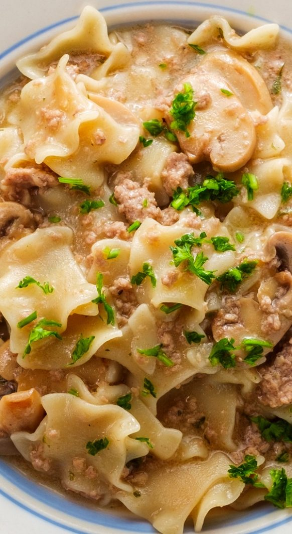 Slow cooker ground beef Stroganoff. Ground beef with mixed wild mushrooms, Dijon mustard, and vegetables cooked in a slow cooker. #slowcooker #crockpot #beef #stroganoff #dinner #lunch