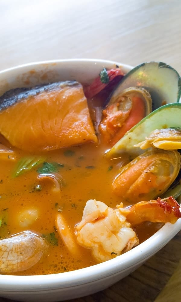 Slow cooker kakavia recipe. This delicious meal belongs to Greek cuisine. Seafood with greens, dry white wine, and vegetables cooked in a slow cooker. #slowcooker #crockpot #dinner #soup #seafood #kakavia