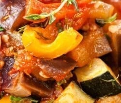 Slow cooker traditional ratatouille recipe. This is a slow-cooked version of the French traditional ratatouille, which includes typical vegetables-eggplants, bell peppers, tomatoes, onions, and squash. #slowcooker #crockpot #dinner #vegetarian #veagn #ratatouile